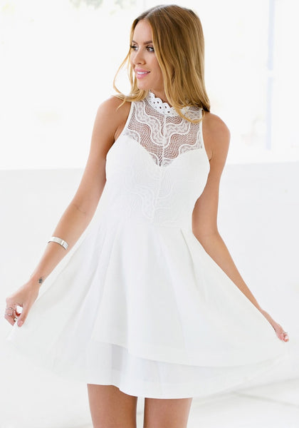 Front view of model in white lace illusion neck dress