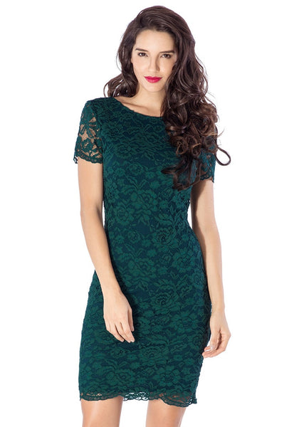 Front view of model ingreen lace overlay shift dress