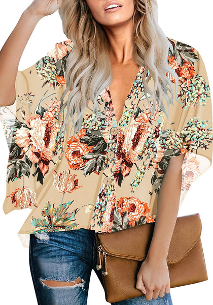 Front view of model wearing apricot V-neck button-up loose kaftan floral top