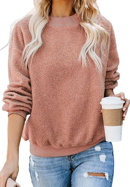 Front view of model wearing apricot crewneck terry cashmere pullover sweatshirt