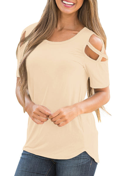 Front view of model wearing apricot crisscross cutout shoulder blouse