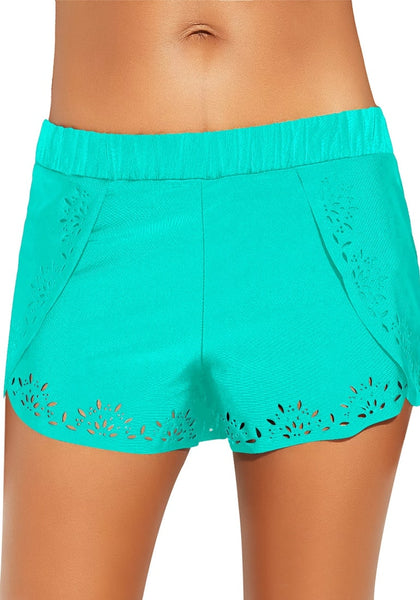 Front view of model wearing aqua blue crochet cutout overlay swim shorts