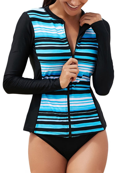 Front view of model wearing aqua blue striped zip-front long sleeves rash guard