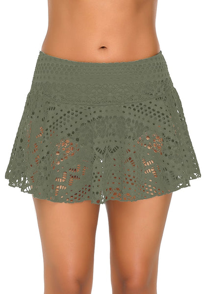Front view of model wearing army green lace crochet swim skirt.