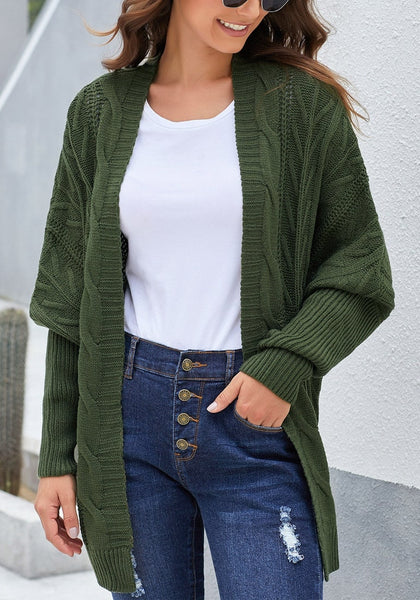 Front view of model wearing army green open-front oversized cable knit cardigan