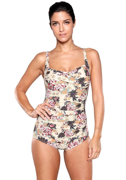 Front view of model wearing beige floral-print ruched swimsuit