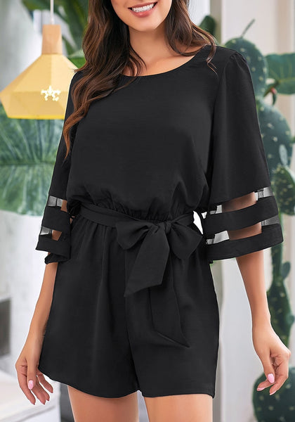 Front view of model wearing black 34 bell mesh panel sleeves belted romper