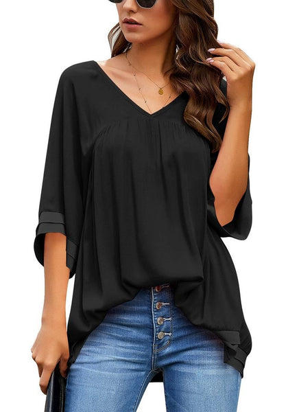 Front view of model wearing black V-neck bell sleeves layered loose tunic top