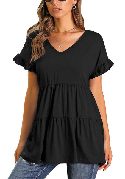 Front view of model wearing black V-neck ruffled short sleeves tiered tunic top