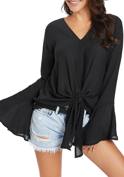 Front view of model wearing black V-neck trumpet sleeves tie-front blouse