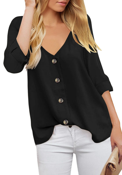 Front view of model wearing black V-neckline 34 cuffed sleeves button-up loose top.