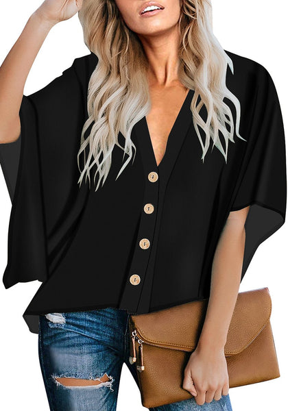 Front view of model wearing black V-neckline button-up loose kaftan top