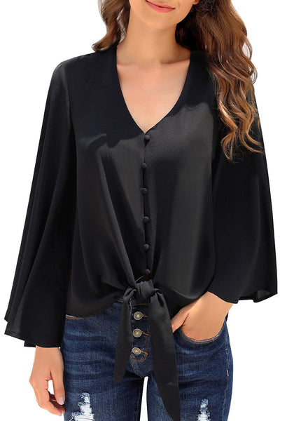 Front view of model wearing black V-neckline button loop loose top