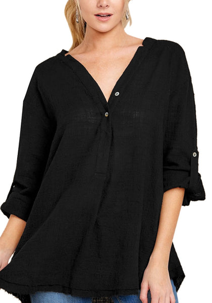 Front view of model wearing black V-neckline roll-tab sleeves loose tunic top