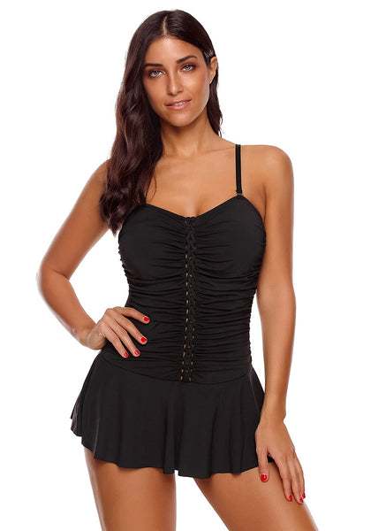 Front view of model wearing black braided-front ruched skirted swimsuit