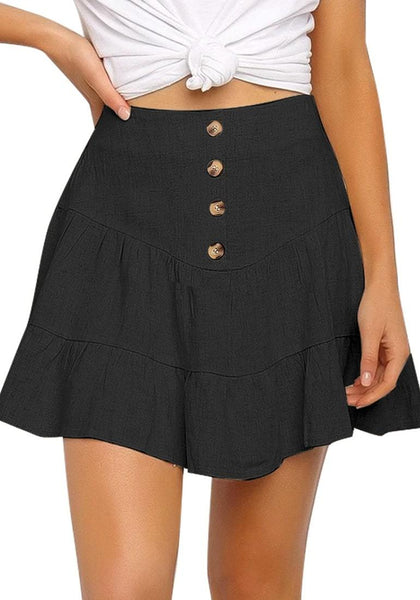 Front view of model wearing black button-front elastic-back ruffled mini skater skirt