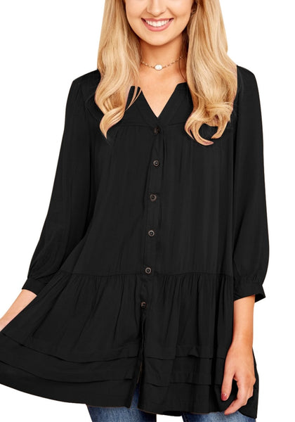 Front view of model wearing black button-front puffed sleeves tunic