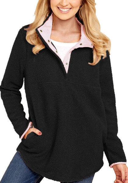 Front view of model wearing black button-front pullover