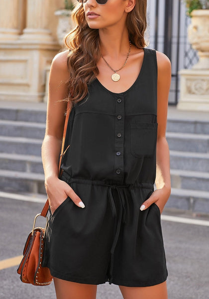Front view of model wearing black button-up drawstring-waist sleeveless romper