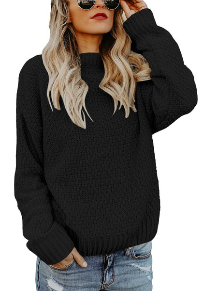 Front view of model wearing black crew neck velvet cable knit pullover sweater