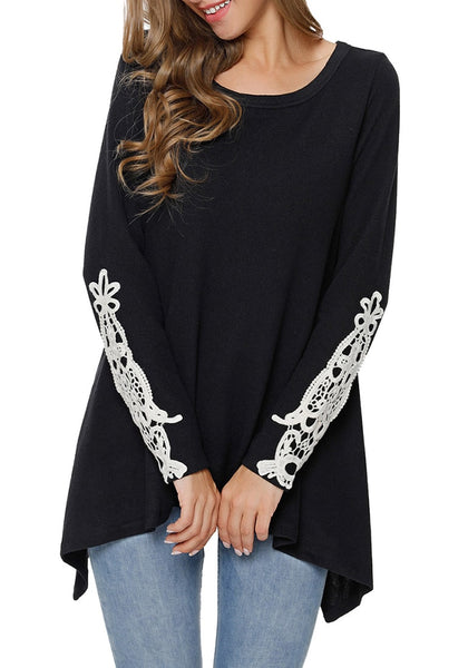 Front view of model wearing black crochet applique long sleeves asymmetrical top