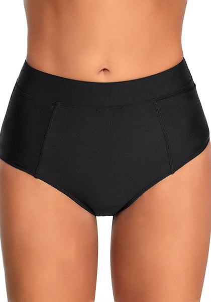 Front view of model wearing black elastic mid-waist side pockets bikini bottom