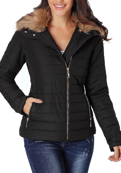 Front view of model wearing black faux fur collar zip up quilted jacket