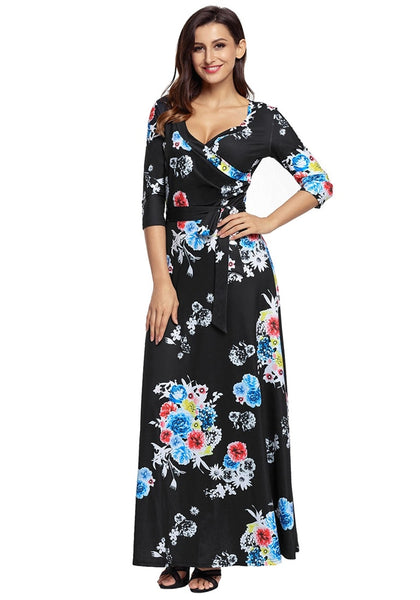 Front view of model wearing black floral print boho long faux wrap dress