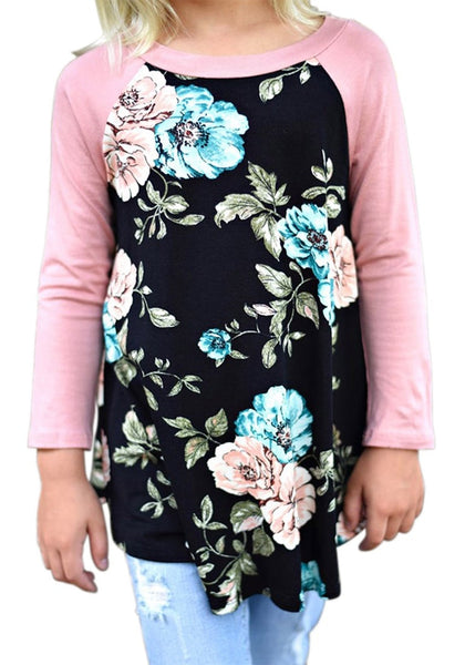 Front view of model wearing black floral print raglan sleeves girl tunic for her