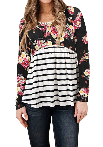 Front view of model wearing black floral striped empire-cut top