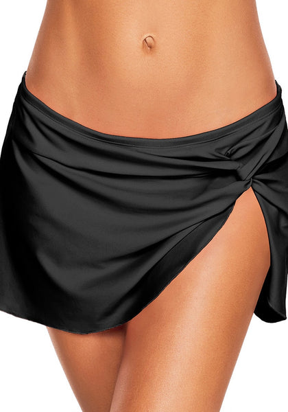 Front view of model wearing black front-twist slit swim skirt