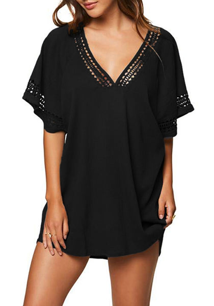 Front view of model wearing black hollow-out oversized beach cover-up