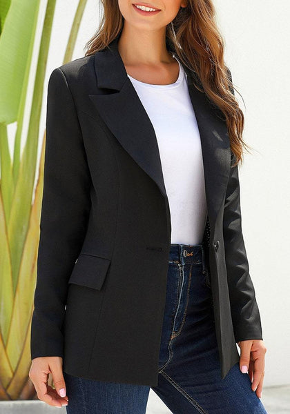 Front view of model wearing black lapel front-button side-pockets blazer