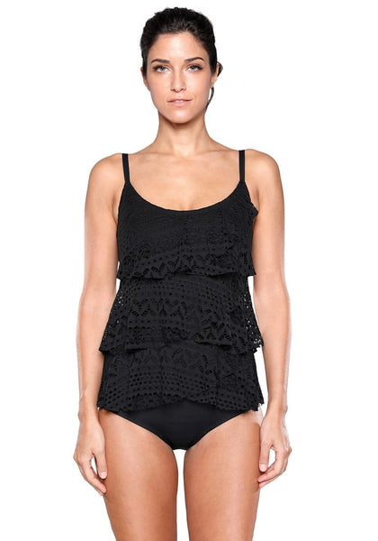 Front view of model wearing black layered ruffle swimsuit