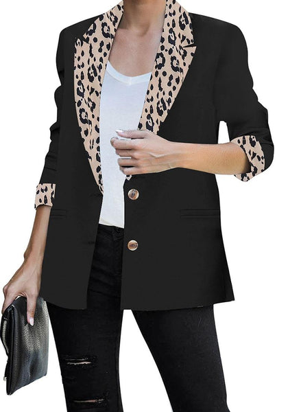Front view of model wearing black leopard-printed notch lapel collar blazer