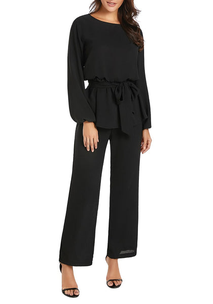 Front view of model wearing black long sleeves slit-back peplum jumpsuit