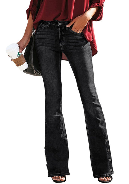 Front view of model wearing black mid-waist side buttons flared denim jeans