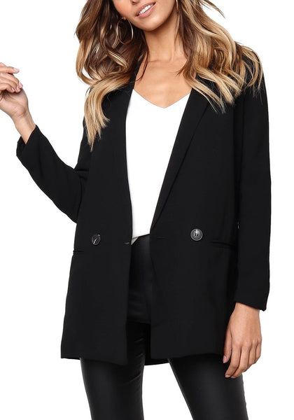 Front view of model wearing black mock-pocket double-breasted lapel blazer
