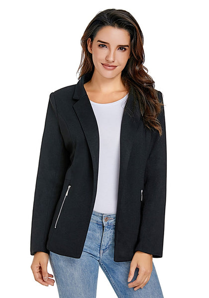 Front view of model wearing black notched lapel side zip blazer