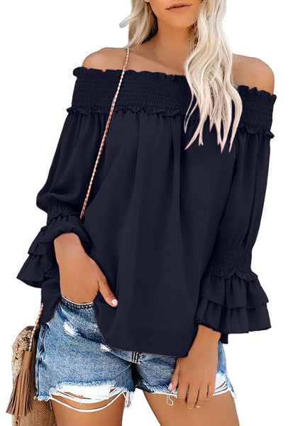 Front view of model wearing black off-shoulder ruffle bell sleeves blouse