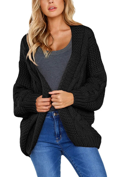 Front view of model wearing black open-front chunky knit sweater cardigan