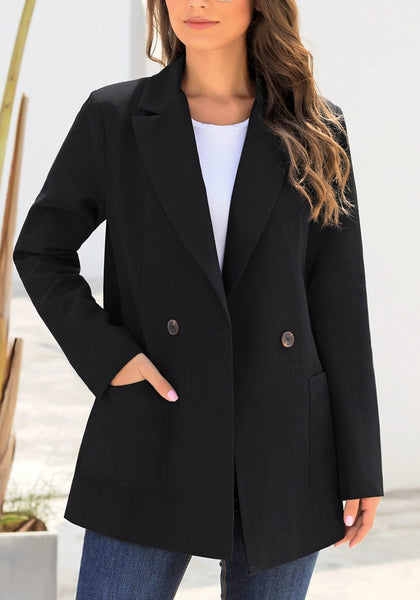 Front view of model wearing black oversized pockets double-breasted blazer