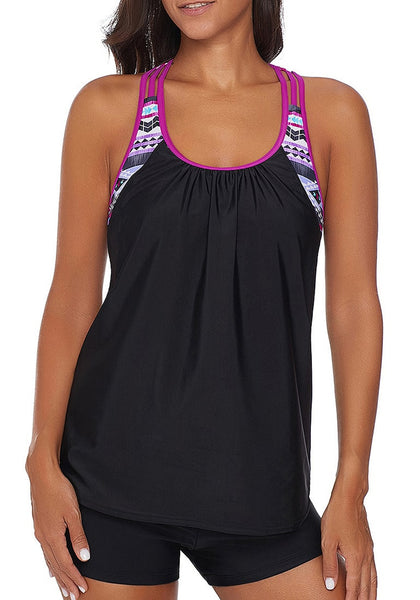Front view of model wearing black racerback double-up tankini
