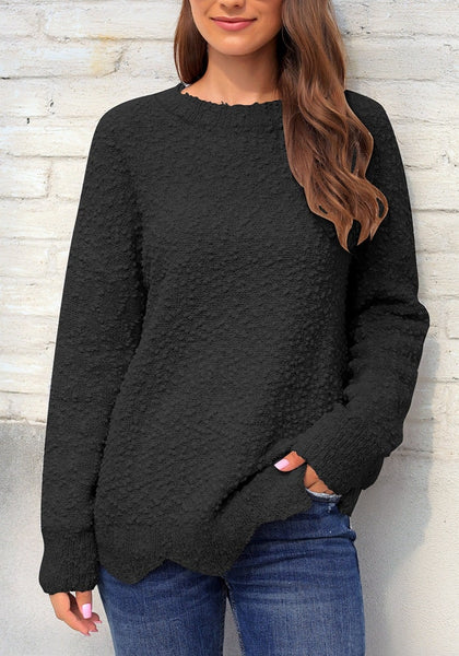 Front view of model wearing black scalloped hem fleece knit pullover sweater