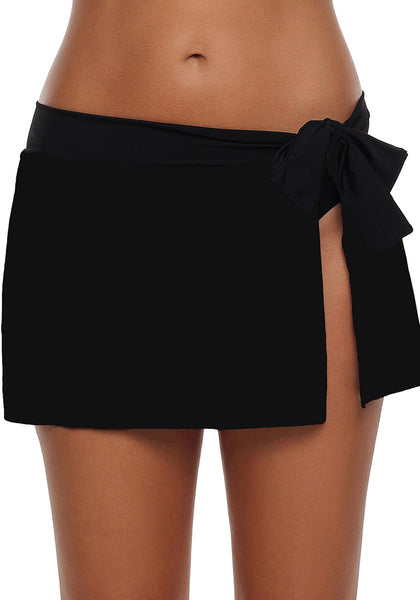 Front view of model wearing black side slit bowknot swim skirt