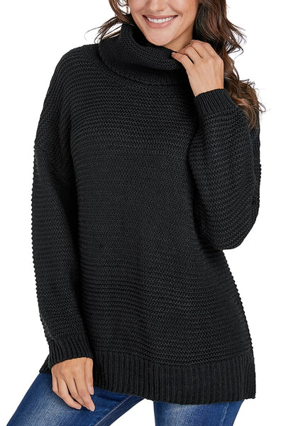 Front view of model wearing black side slit turtleneck textured knit sweater