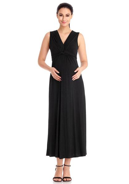 Front view of model wearing black sleeveless A-line long maternity dress
