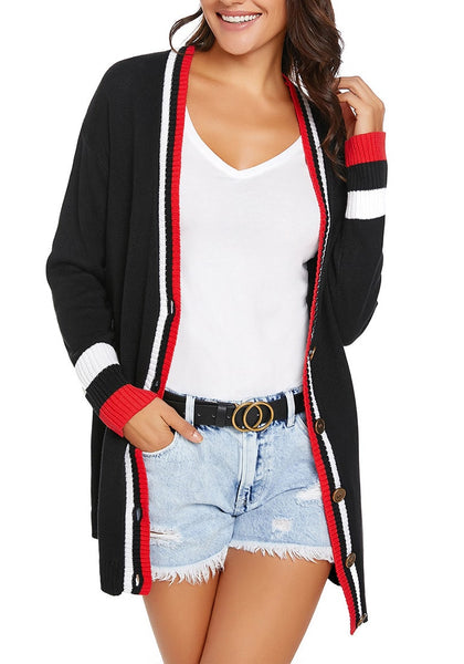Front view of model wearing black striped trim button-up knit cardigan