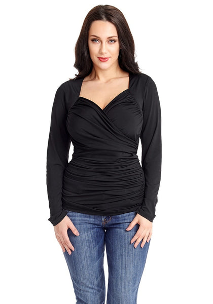 Front view of model wearing black sweetheart neckline ruched surplice top