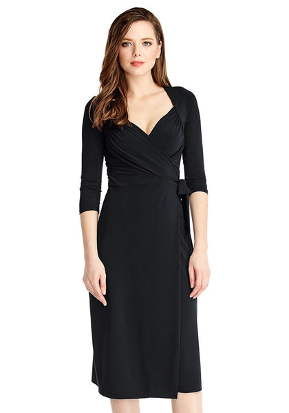 Front view of model wearing black sweetheart neckline wrap dress